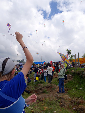 flying small kites. Giant Kites, Bright Colors, and a Graveyard: Guatemala's Day of the Dead